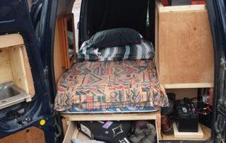 back view of ford transit custom camper van conversion in golden, colorado