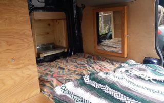 mirror and various woodwork in ford transit custom camper van conversion in golden, colorado