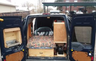 full back view of the ford transit custom camper van conversion in golden, colorado
