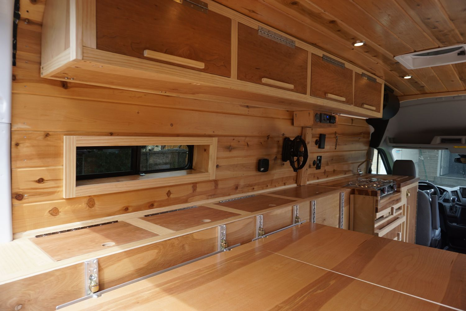woodwork on ford transit 350 custom camper van conversion in golden, colorado